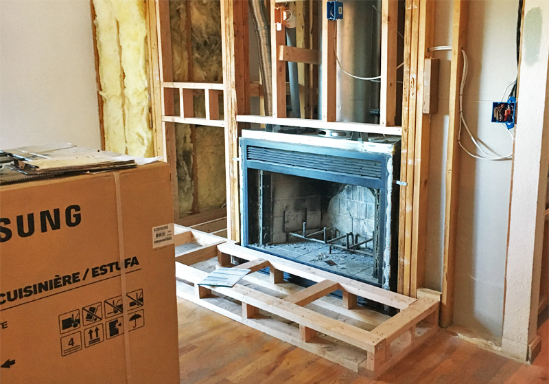 Home projects wood burning fireplace to gas insert for Wood burning fireplace construction